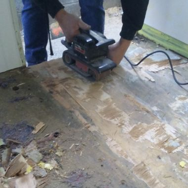 sanding down the floor